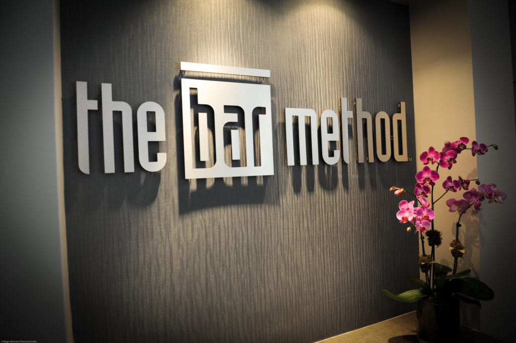 Bar Method Logo behind front desk at the Bar Method Winter Park Village