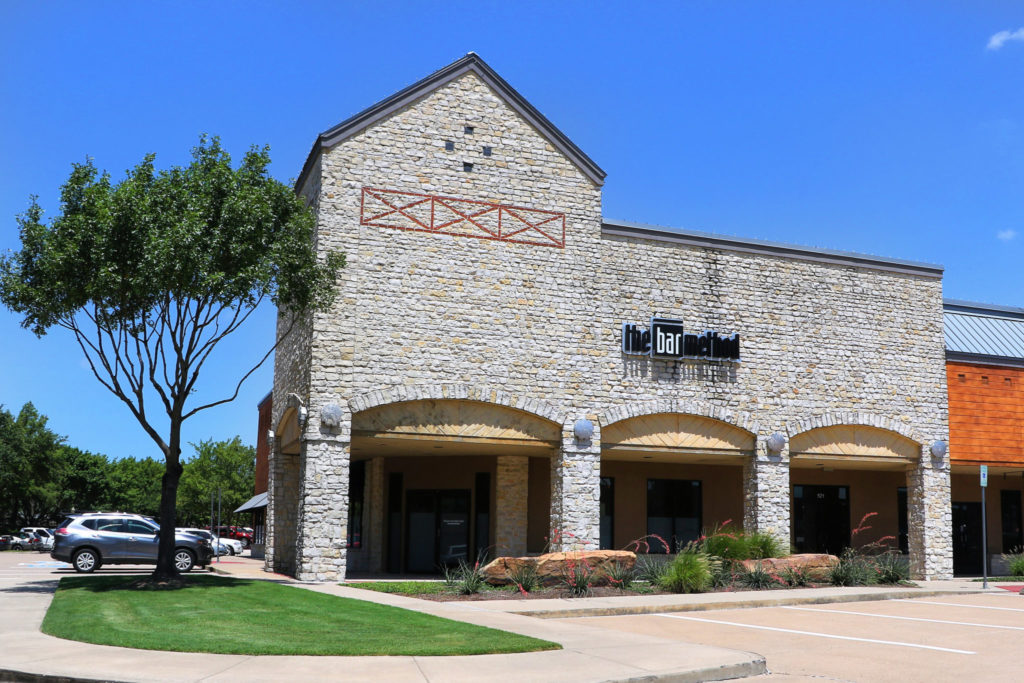 Front of building at the bar method plano