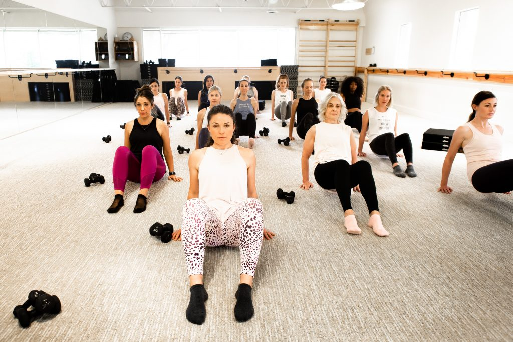 women performing in barre class at the bar method in cherry creek