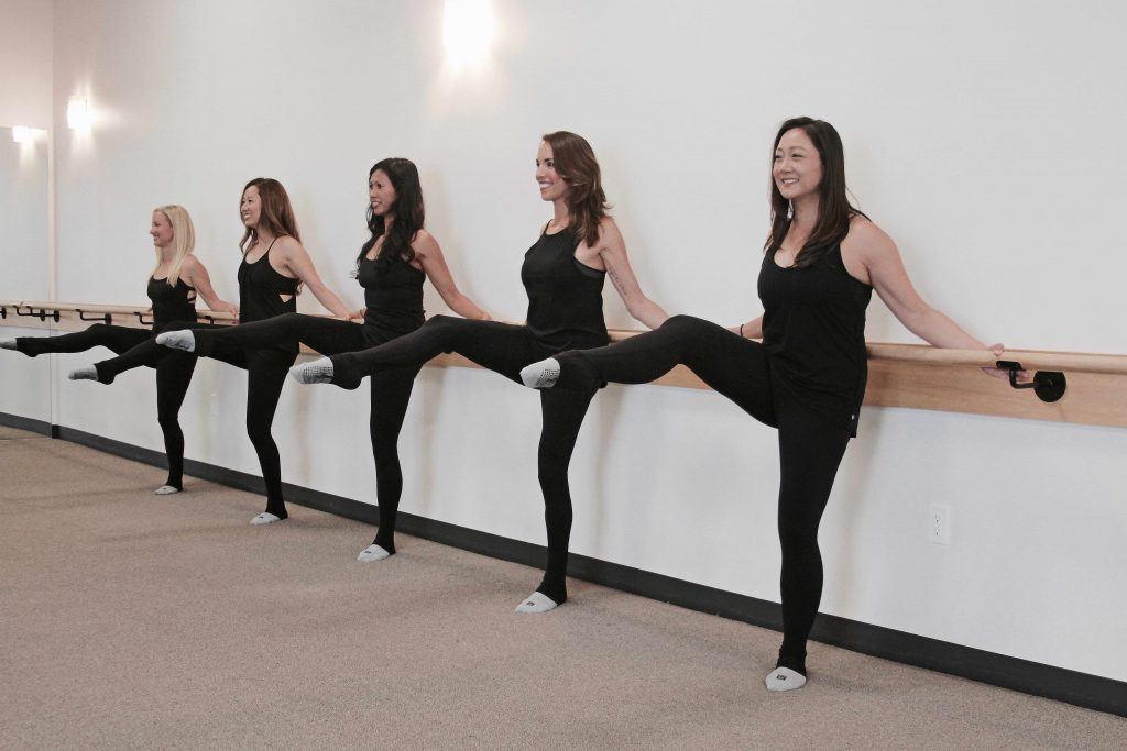 Barre class leg lifts at The Bar Method Tustin