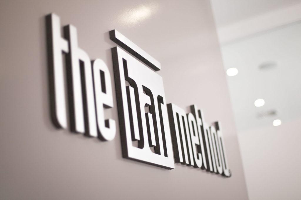 The bar method logo behind the front desk at The Bar Method Palos Verdes