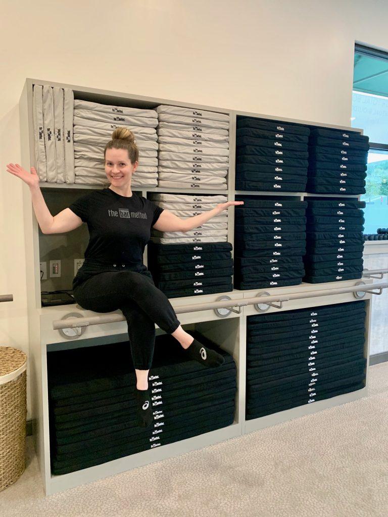 Kimberly sitting on mat storage unit