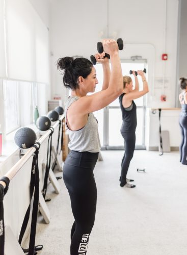 woman performing arm exercise